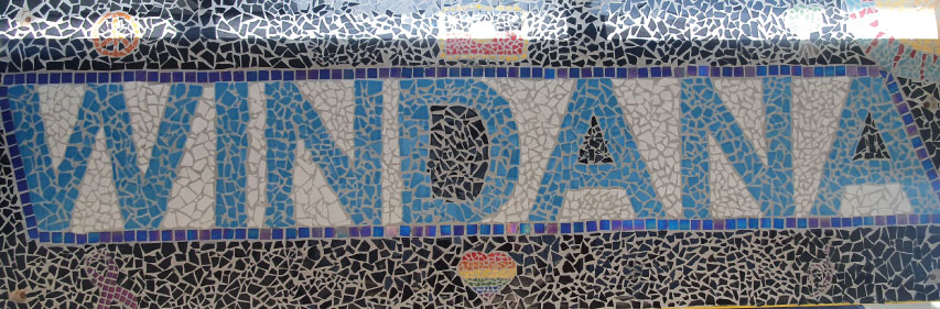 """A mosaic spelling out the word """"Windana"""" in blue tiles against white."""